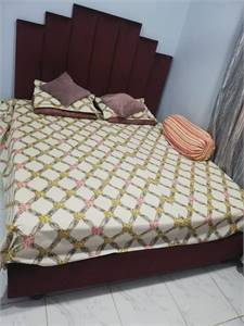 Bed with spring mattress and wardrobe