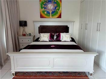 King size bed with two side table