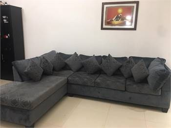 L-shaped sofa with cusions in mint condition