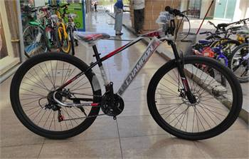 Mountain bike with helmet 29 inch wheel